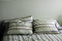 4-new-down-pillows-on-bed.jpg