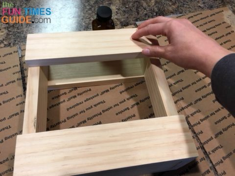 Gluing the horizontal boards to the other side of the frame for this wooden utensil holder.