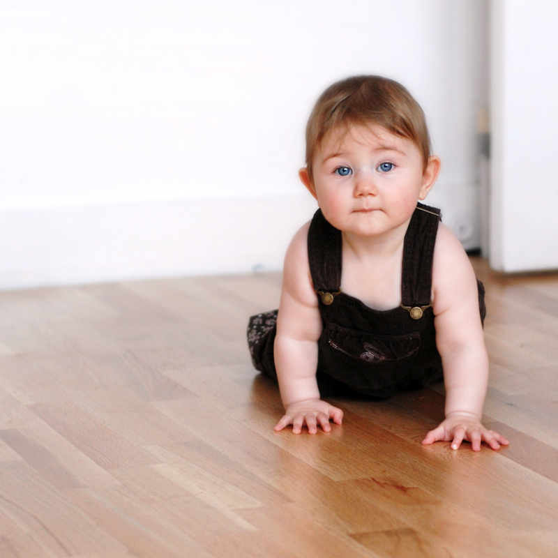 hardwood floor and child