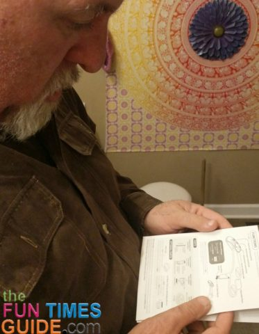 Hubby reading the Superior Bidet instructions