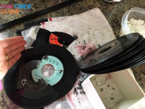 I had plenty of extra 45 vinyl records to replace the ones that broke during the drilling process. If you use 2 clamps to create even tension, the drilling shouldn't break any records.