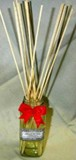 Diffuser reeds in a glass vase.