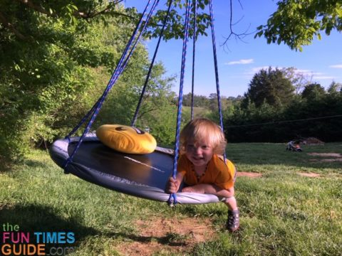 See how I used a small fitness trampoline to make a saucer swing for my toddler to enjoy.