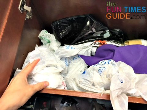 Folding plastic bags together into neat and compact bundles eliminates cluttered spaces like this!