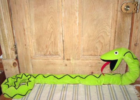 A dragon snake DIY door stopper as pictured in Good Housekeeping with tutorial.