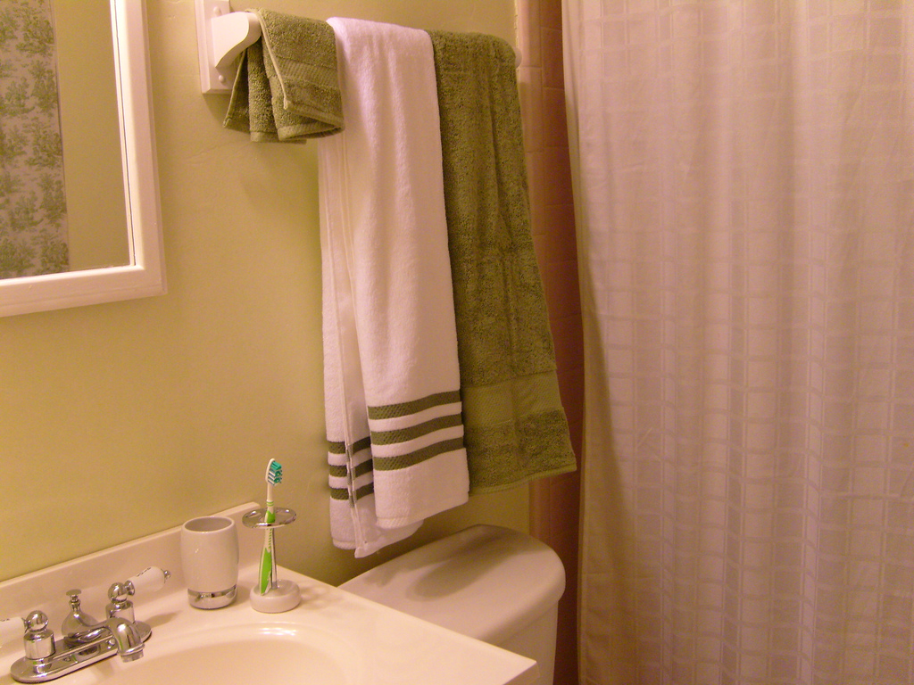 How To Fold Towels Keep Them Hanging Straight In Your Bathroom