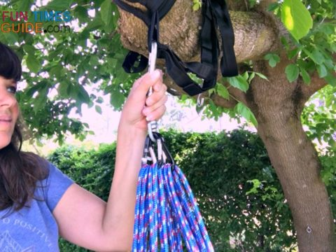 Hooking the ropes up to the hammock straps.
