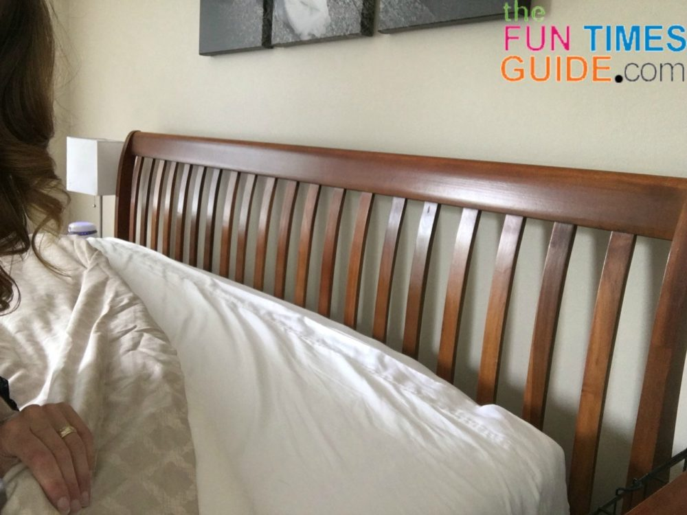 This is step 5A to make a bed fast -  Take the top of the top sheet and fold it down under the duvet.