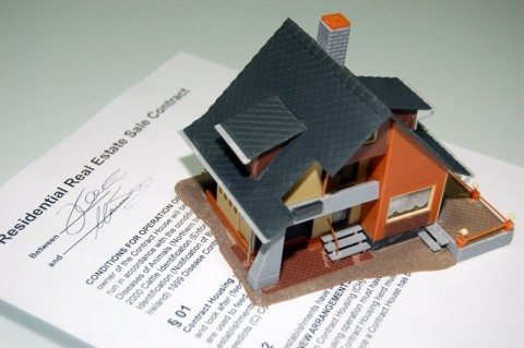 A home contract and house for sale.