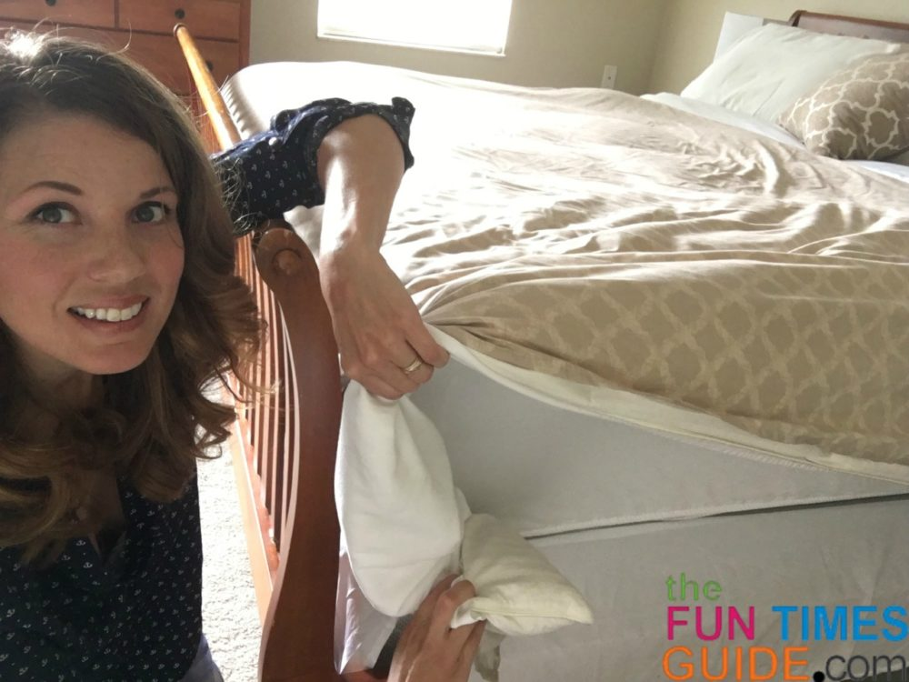 This is step 6B to make a bed fast - pull the excess bedding out to the side until you can see the mattress.