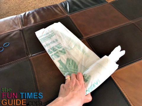 I'll show you how to fold plastic bags into small, self-dispensing bundles like this - so you can pull out only one at a time.