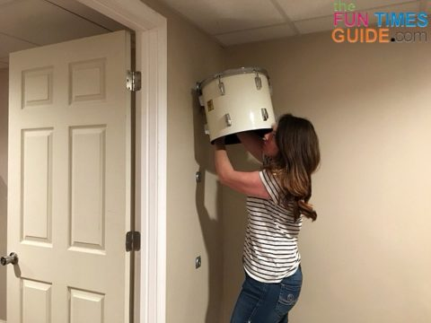 Installing the first drum on the wall.