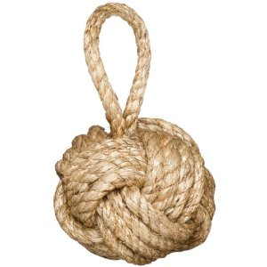 Jute large knot rope ball that's meant to be a door stop.