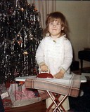 Lynnette... age 4... proud as can be with a new ironing playset on Christmas morning.