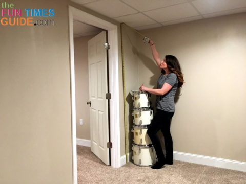 Taking measurements from floor to ceiling.