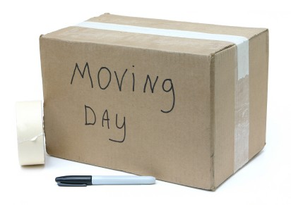 A few of the things you need when packing for a move: moving boxes, packing tape, and Sharpie marker. See our list of other other moving supplies you might forget!