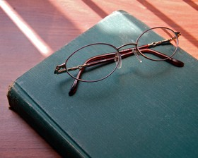 old_reading_glasses_and_book_by_ladyheart.jpg
