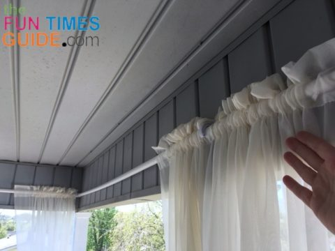 This is what it looks like with the curtain panels hanging on the DIY outdoor curtain rods.