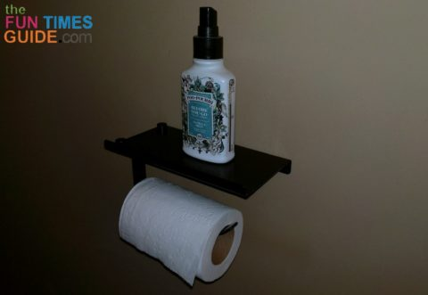 This toilet paper shelf is perfect for holding a bottle of Poo Pourri toilet spray in the guest bathroom!