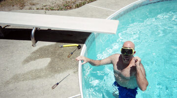 jim fixing the light in the pool