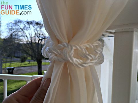 A closeup of the white rope curtain ties I use on our front porch curtains.
