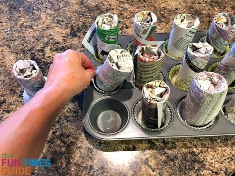 Remove the stuffed cardboard tubes from the cupcake pan by pulling on the cupcake wrapper (to keep the wicks in place).