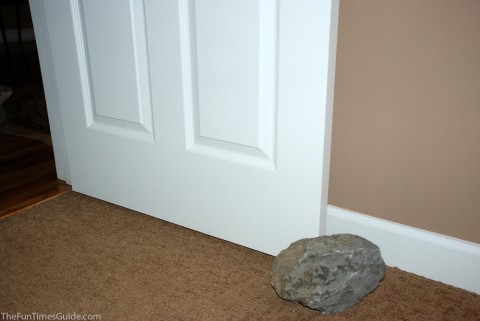 Using a large rock as a doorstop in my husband's office.