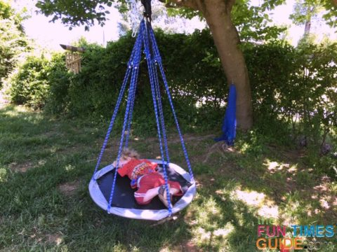 As you can see, this saucer swing is the perfect size for my toddler son, but it's not big enough for both of us to lounge on it together.