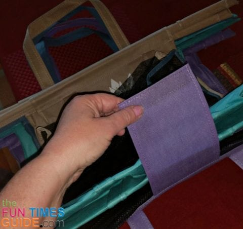 This is the thick cover strap that is used to securely velcro the set of 4 Lotus Trolley Bags together when they're not being used.
