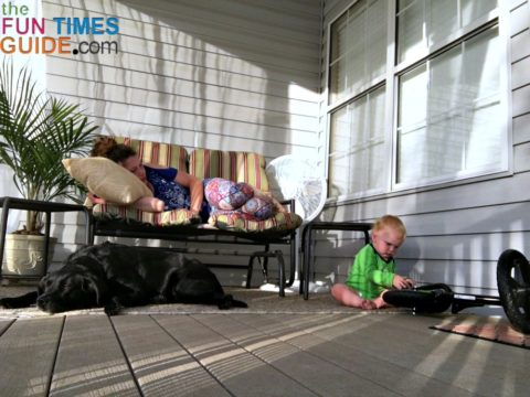 Enjoying our breezy porch with baby and pets - it's a cozy outdoor space now!