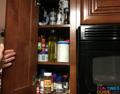My cluttered spice cabinet in the kitchen.