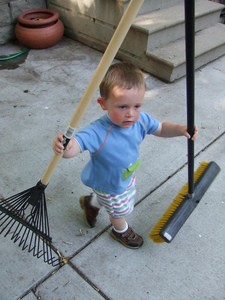 toddler-is-ready-for-yardwork-with-rake-and-broom-by-karindalziel.jpg