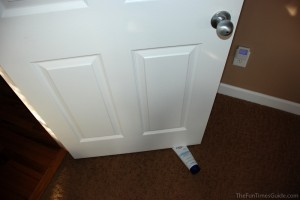 Using a tube bottle as a door stop. photo by Lynnette at TheFunTimesGuide.com