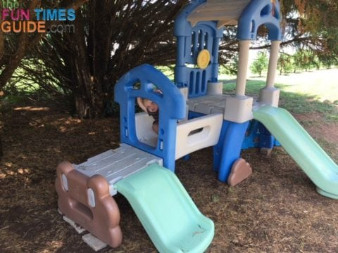 I decided to put the Little Tikes outdoor climber under the shade of our cypress trees in the backyard.