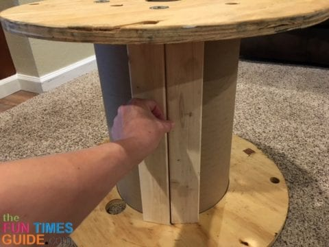 I covered the cardboard center core of the wooden spool with scrap wood pieces.